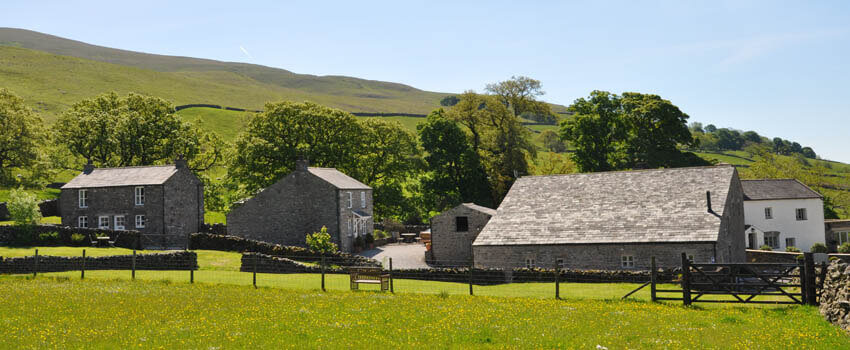 Landscape photo of houses in rural area of Kirkby Lonsdale.