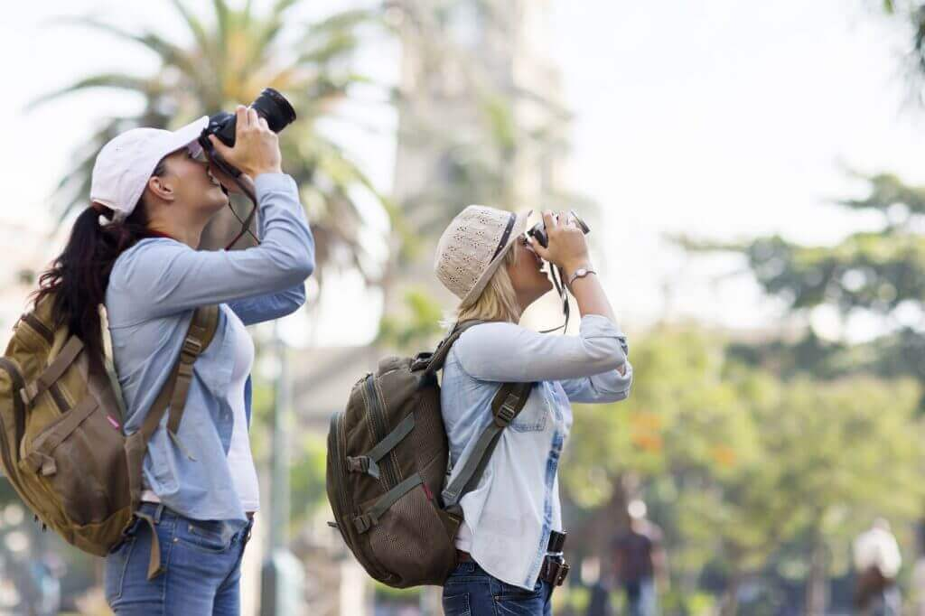 Shallow depth of field photo of tourists taking photograph.