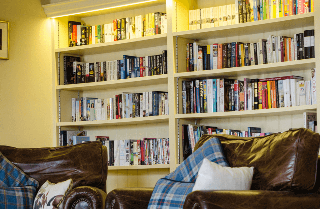 Photo of Mill House's Autumn Cottage library.