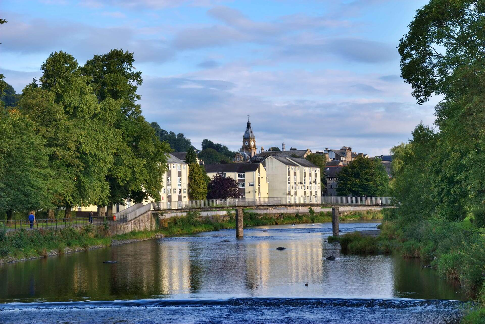 Houses and Greenery Lining the River in Kendal