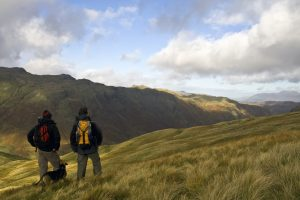 Walkers on Route in Lake District in Autumn
